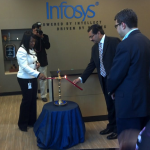 "The traditional Indian ceremony of ""lighting the lamp"" is conducted by India's Consul General Ajit Kumar (center), overseen by Infosys BPO's COO Ritesh Idnani (right)"
